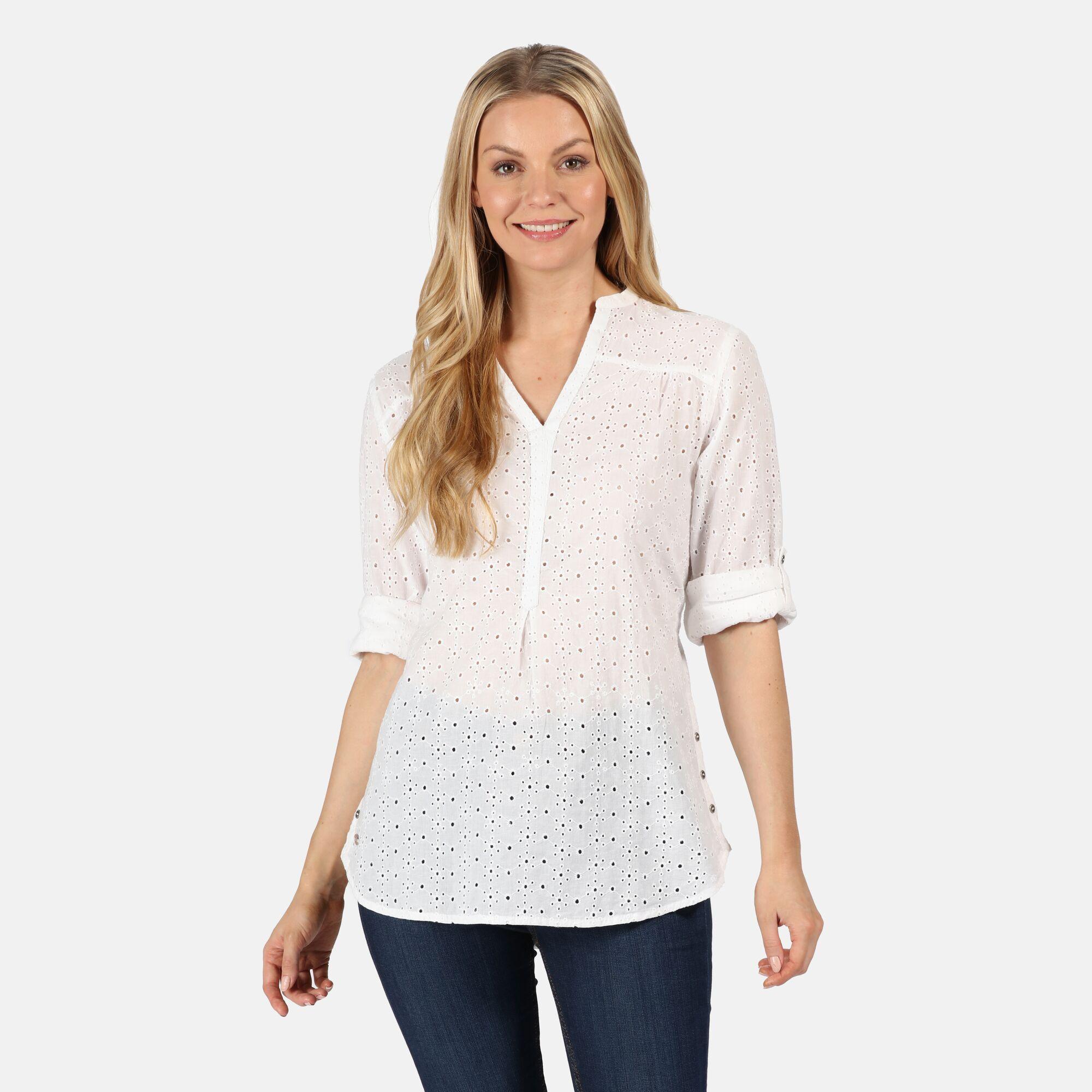 Woman wearing a white blouse.