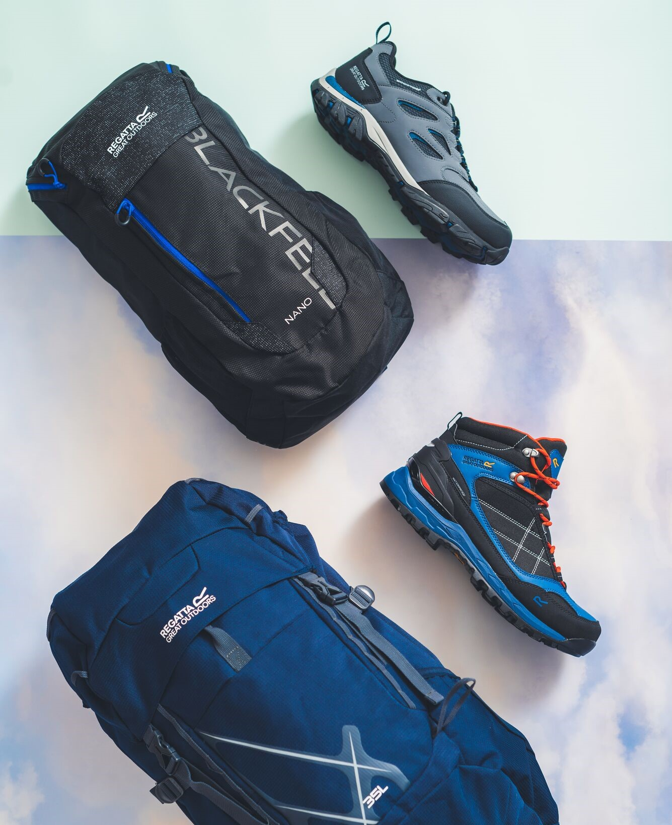 two rucksacks and two pairs of walking shoes