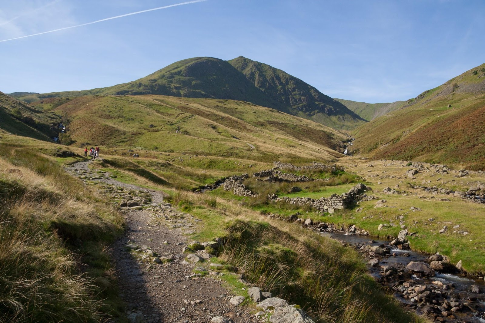 Walkers making their way up the footpath towards Helvellyn in the Lake District
