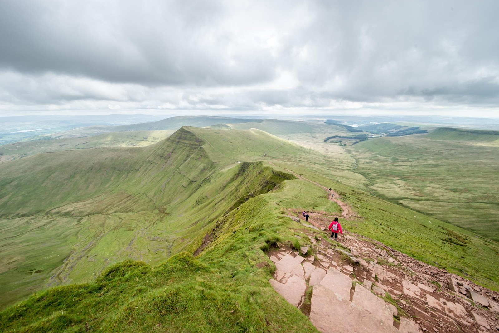 Hikers walking along the top ridge of Pen y Fan in the Brecon Beacons.