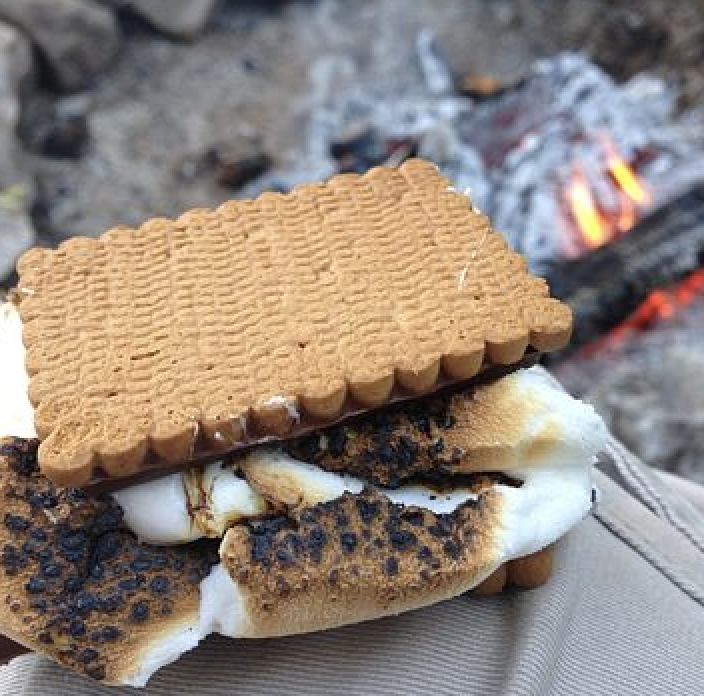 A s'more over the campfire.