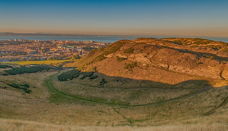 Arthur's Seat with the view of Edinburgh in the distance.