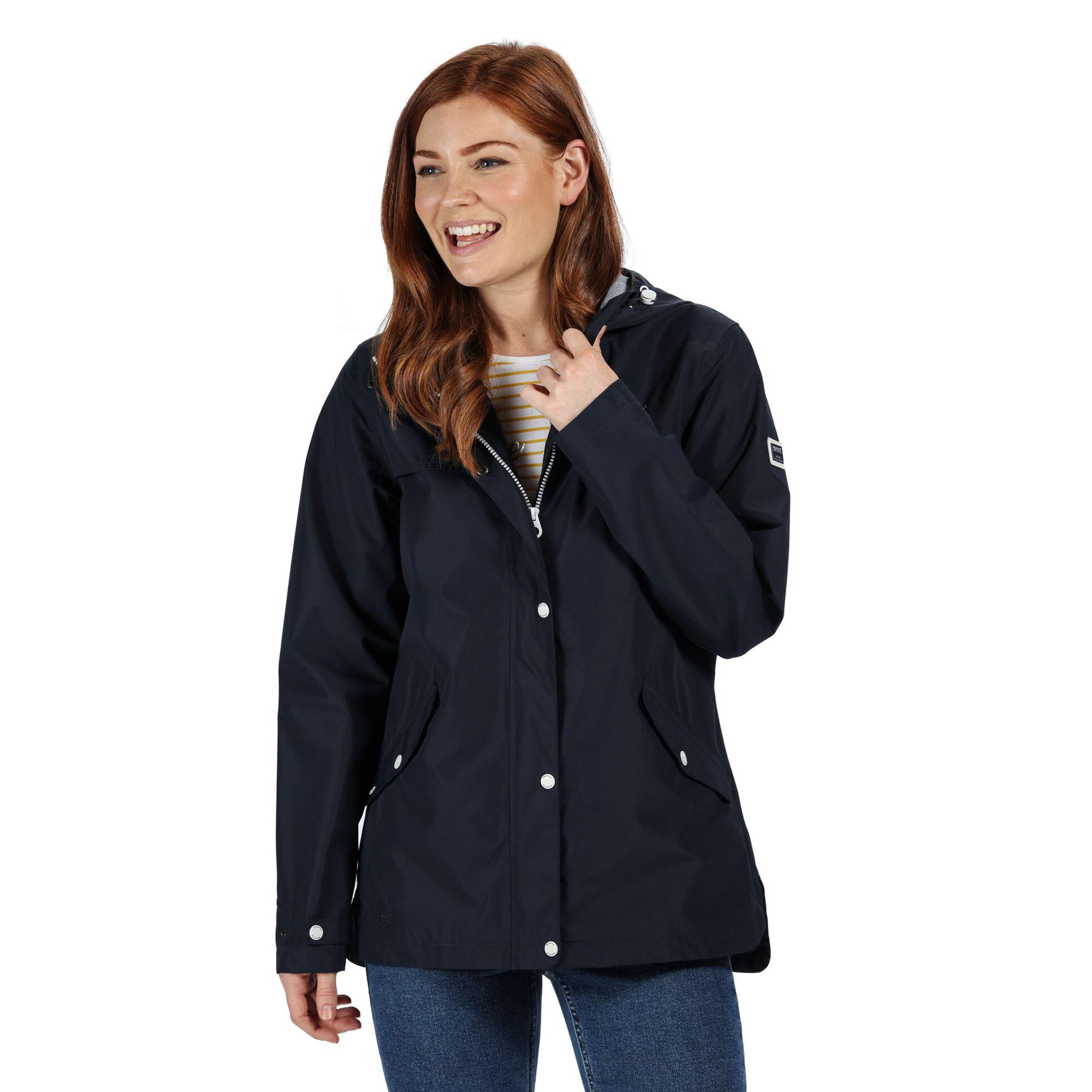 Woman wearing a navy waterproof jacket.