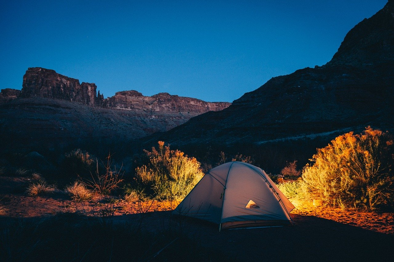 A tent camping in the wilderness.
