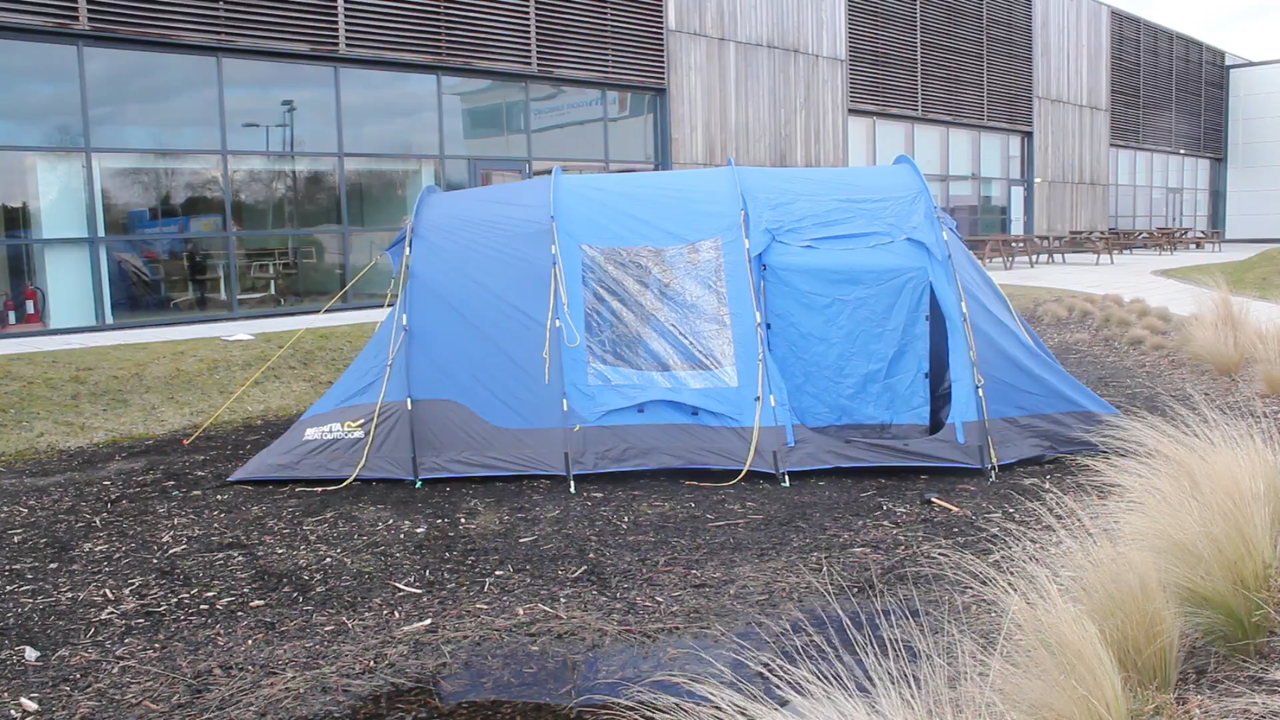 Pitched blue family tent.