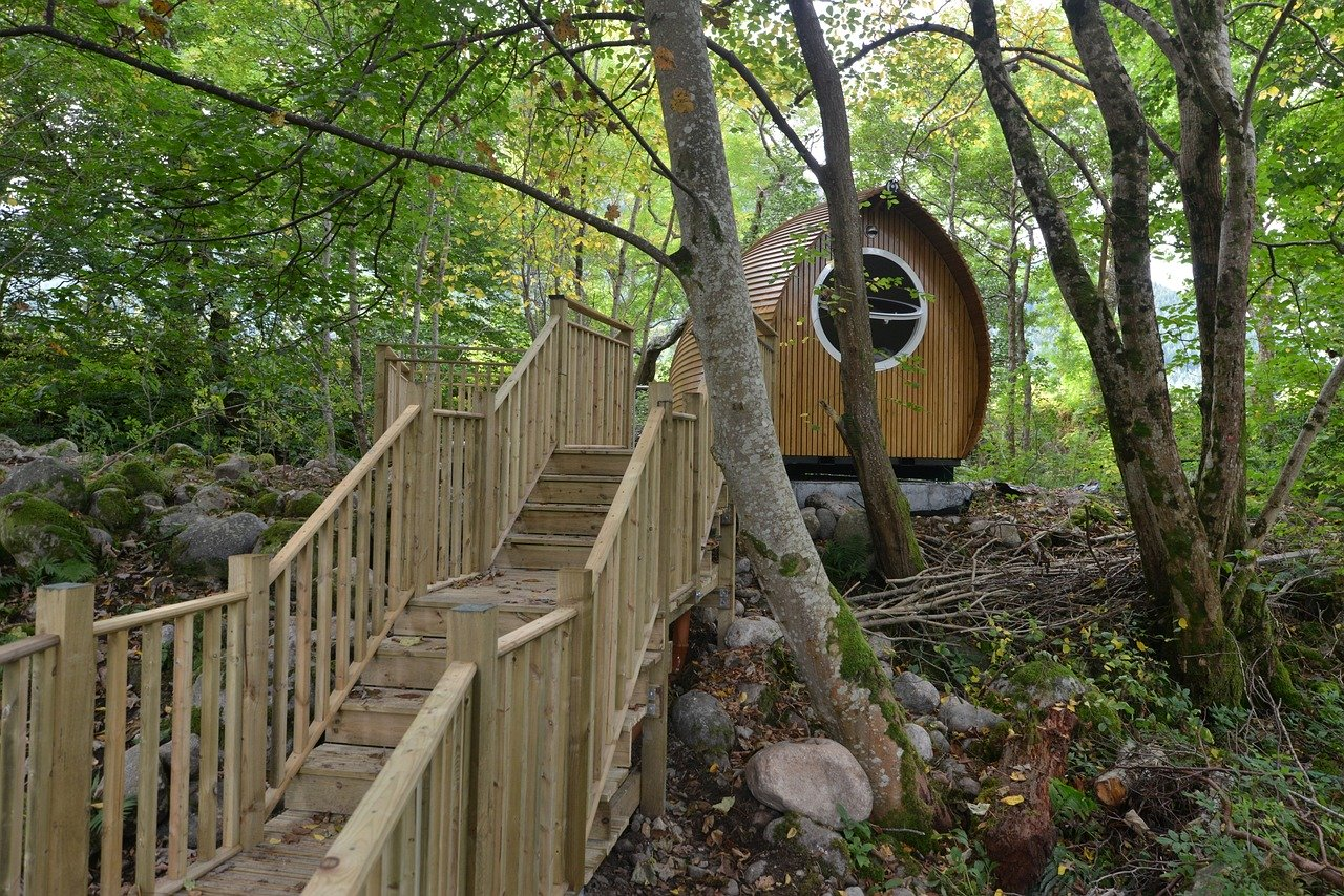 Wooden glamping pod with wooden walkway