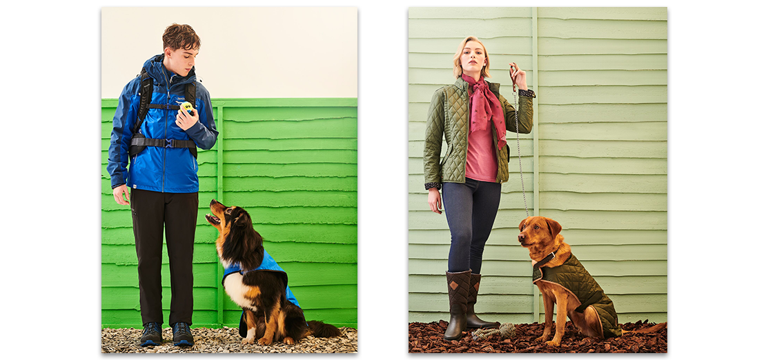 Male and female model with two dogs, wearing matching coats