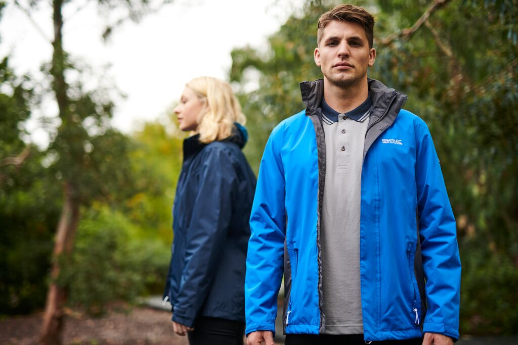 Male and female model wearing waterproof jackets.
