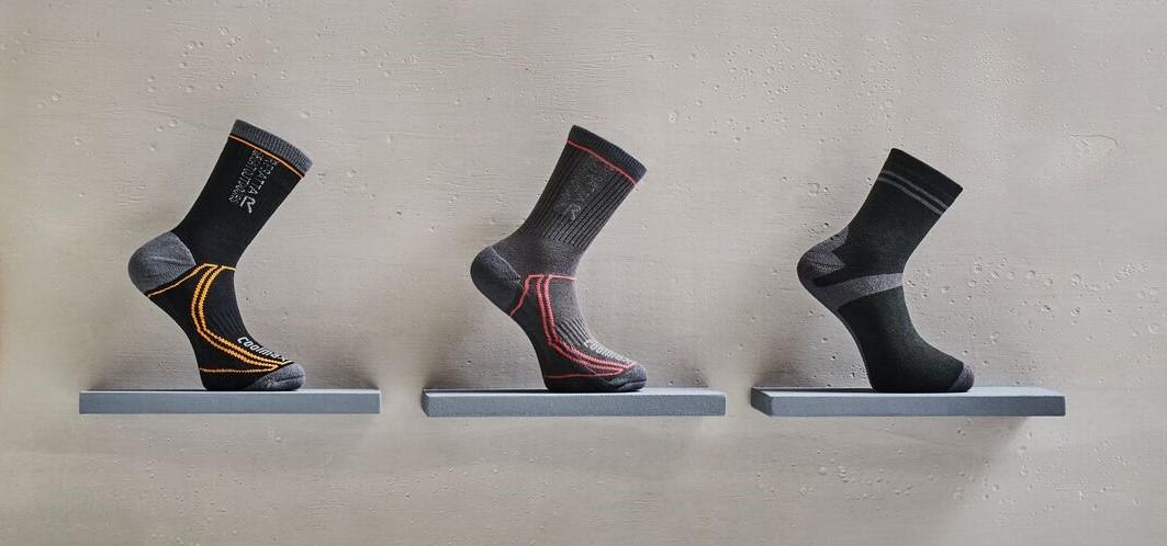 3 pairs of grey walking socks on a shelf.