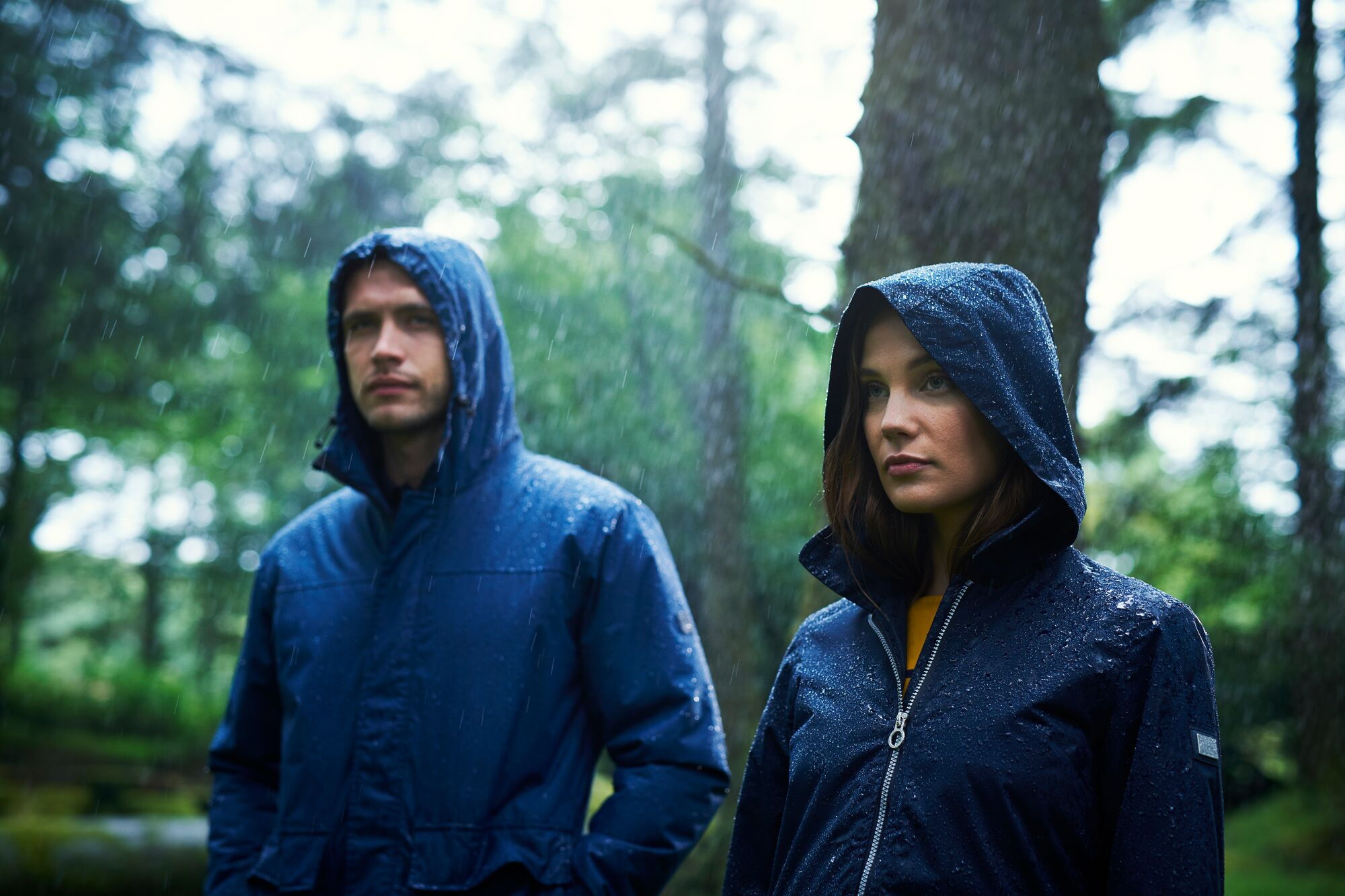 Man and woman wearing waterproof jackets in the rain