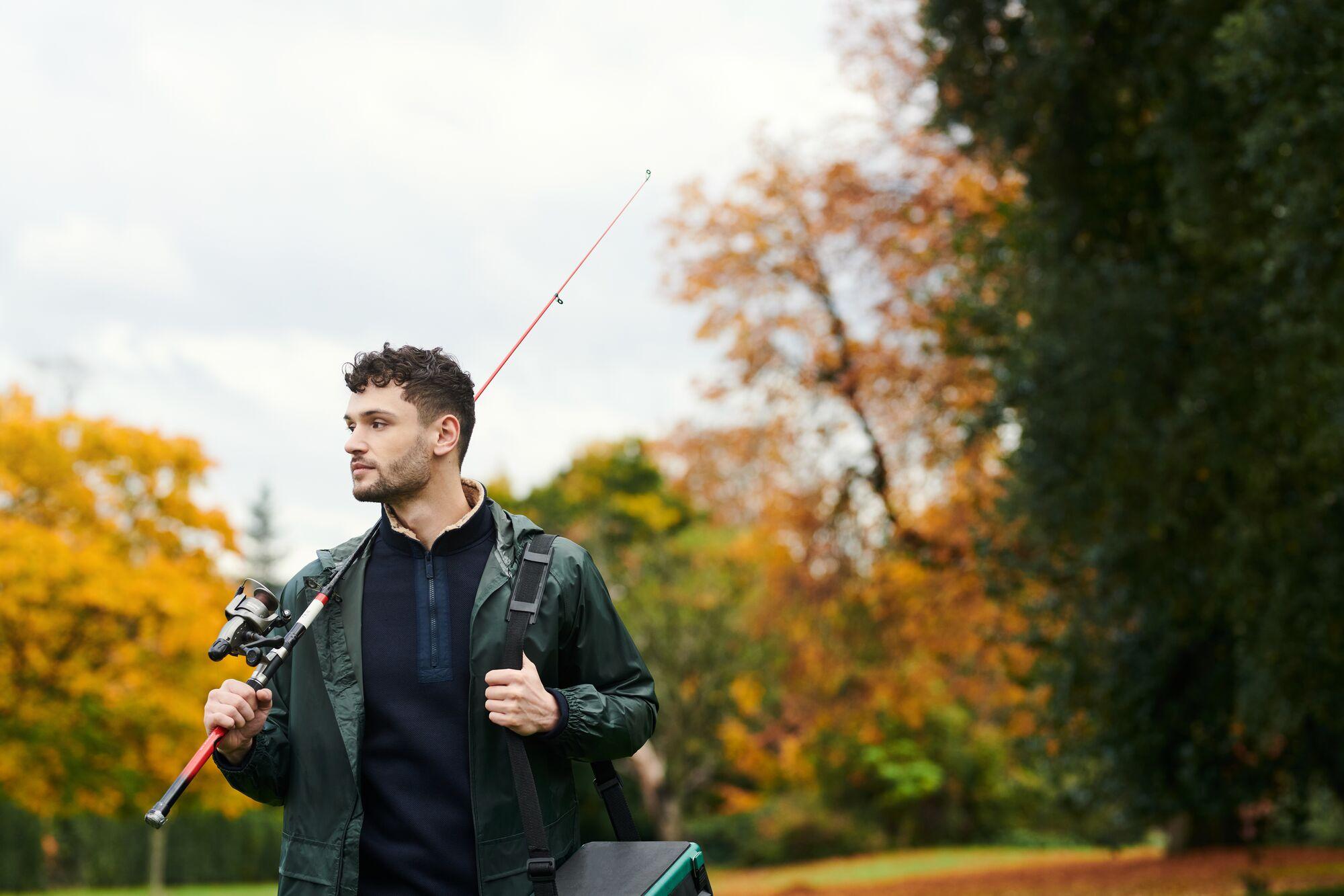Man Carrying Fishing Equipment