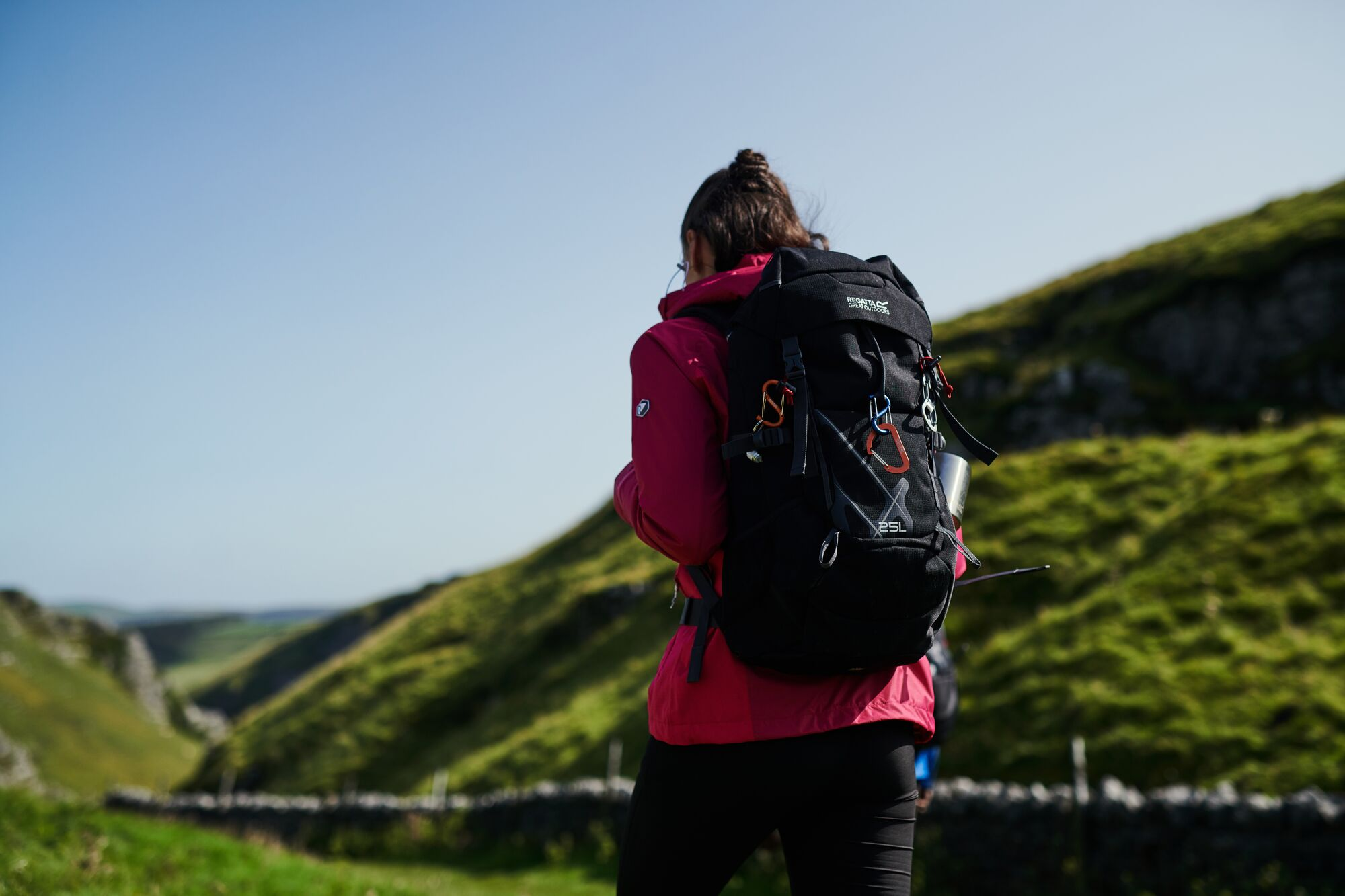 woman walking with a full rucksack