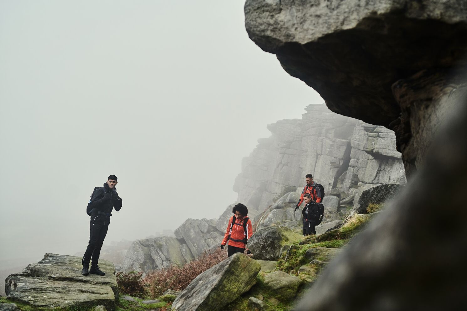 Hikers walking in the foggy mountains