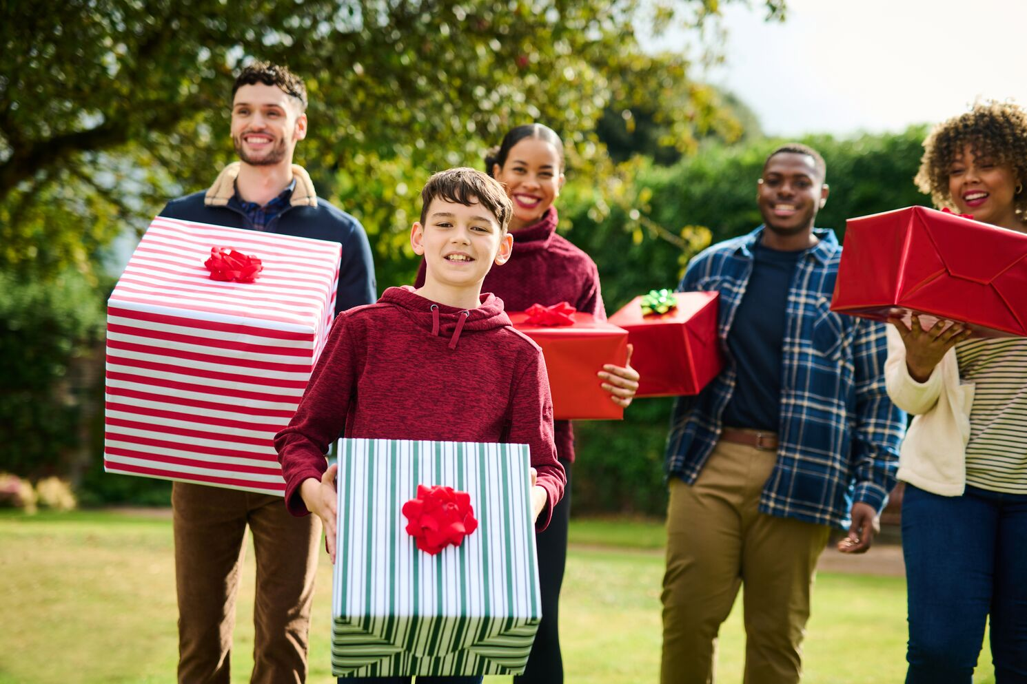 Christmas Gifts for Walkers, a family of 5 holding presents